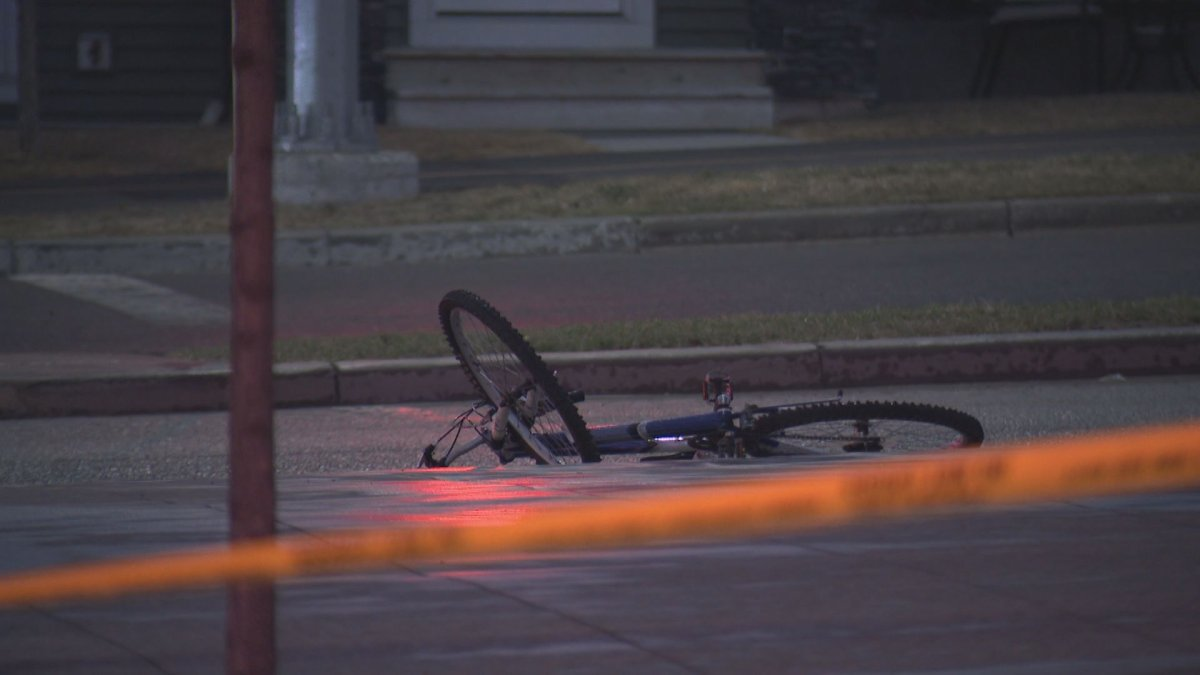 A cyclist was rushed to hospital Thursday night after a collision with a vehicle in Calgary's northwest.