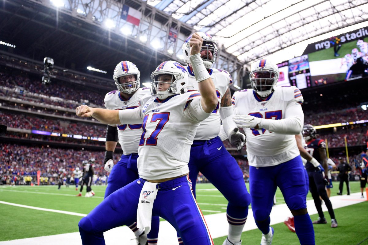 Buffalo Bills quarterback Josh Allen (17) celebrates after catching a pass for a touchdown against the Houston Texans during the first half of an NFL wild-card playoff football game Saturday, Jan. 4, 2020, in Houston.