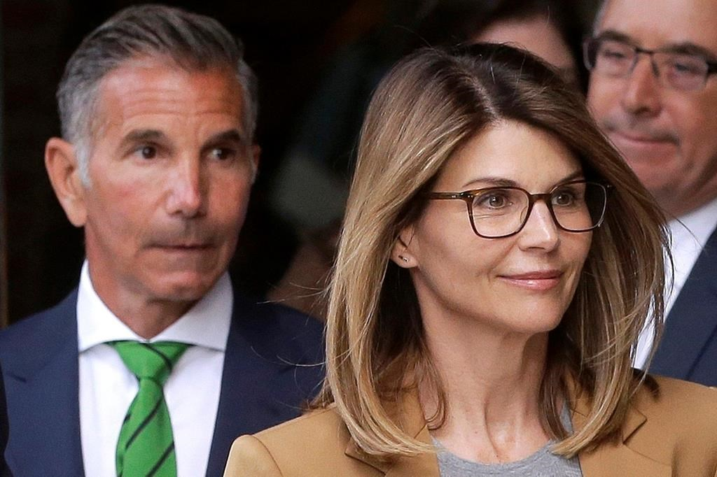 Lori Loughlin, front, and her husband, clothing designer Mossimo Giannulli, left, depart federal court in Boston after a hearing in a nationwide college admissions bribery scandal on April 3, 2019.