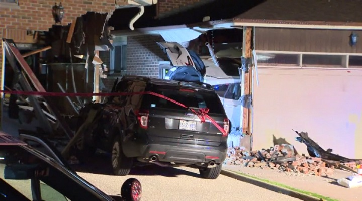 A vehicle crashed into two houses in Markham Thursday evening.