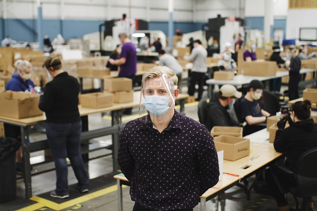 Jeremy Hedges, founder oand CEO of InkSmith and its spin-off Canadian Shield, poses for a photo on the floor of his company's new factory in Waterloo, Ont.