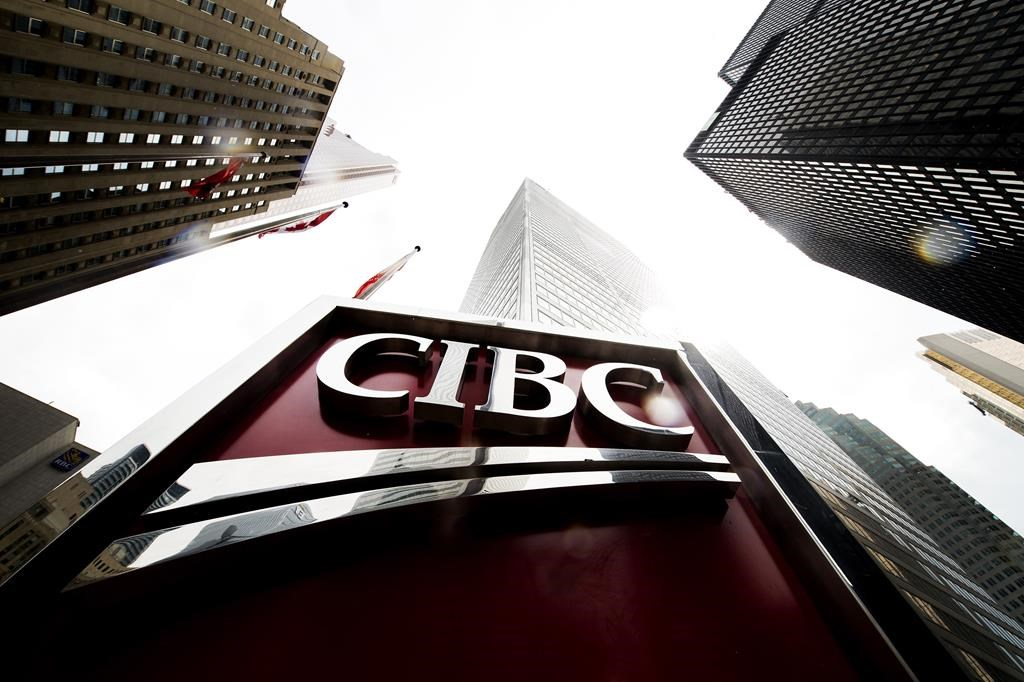 A CIBC sign is shown in the financial district in Toronto on August 22, 2017. THE CANADIAN PRESS/Nathan Denette.