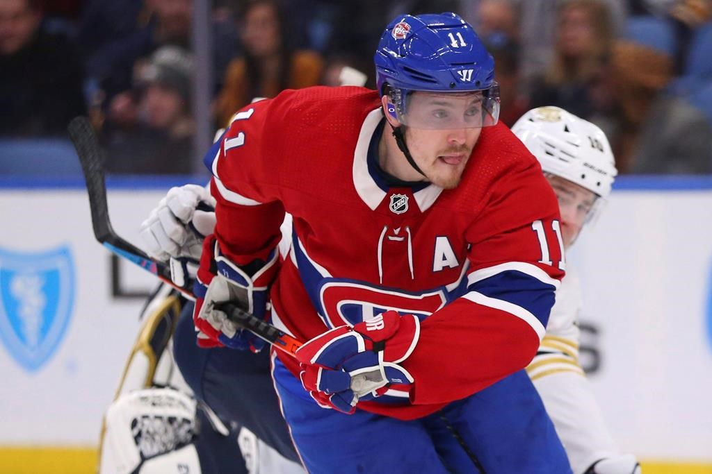 In this file photo, Montreal Canadiens forward Brendan Gallagher (11) skates during the second period of an NHL hockey game against the Buffalo Sabres. The Habs announced they've signed Gallagher to a six-year contract extension. Wednesday, Oct. 14, 2020.