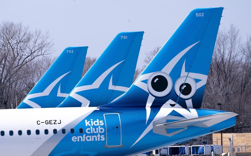 Air Transat aircrafts are seen on the tarmac at Montreal-Trudeau International Airport in Montreal, on Wednesday, April 8, 2020.