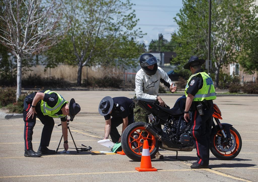 Police test the noise level on motorbikes during the COVID-19 pandemic, in Edmonton on Thursday, May 28, 2020. With less traffic on the roads there has been an increase in speeding and noisy vehicles on the streets. THE CANADIAN PRESS/Jason Franson.