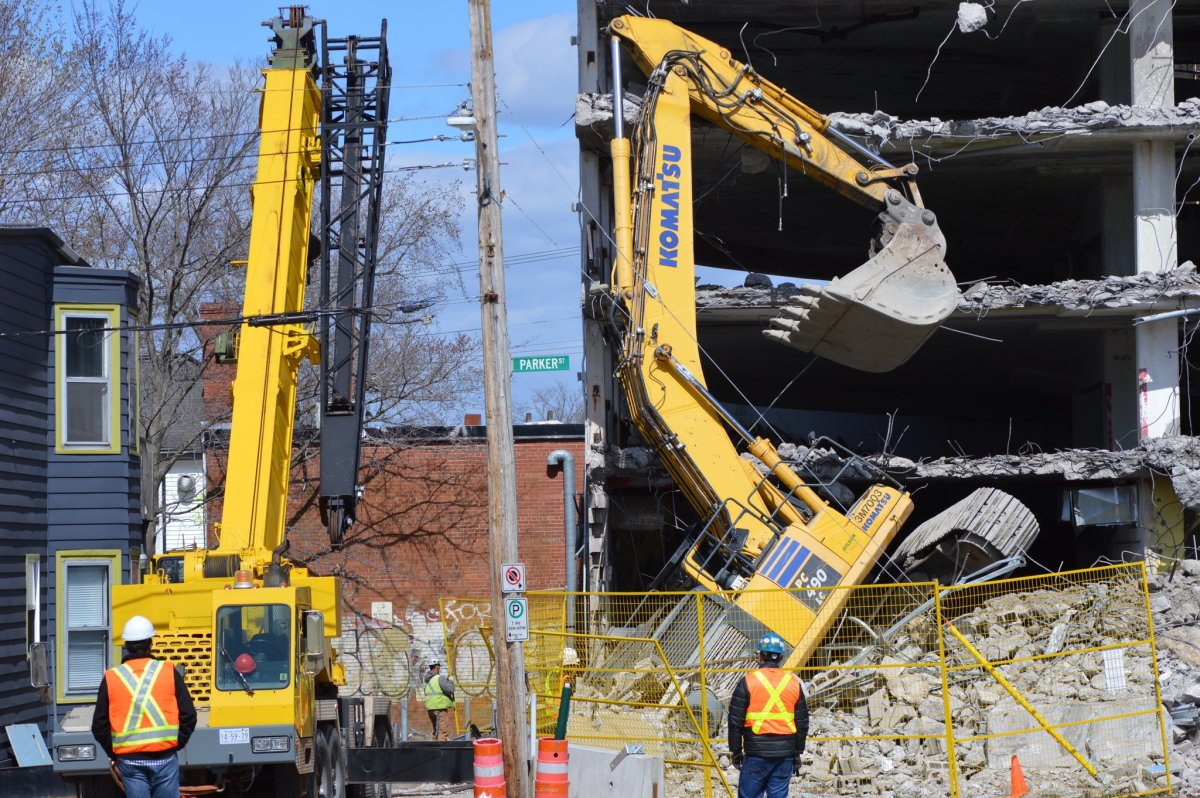 Nova Scotia's Department of Labour is investigating after an excavator tipped over at a construction site on Quinpool Road in Halifax.