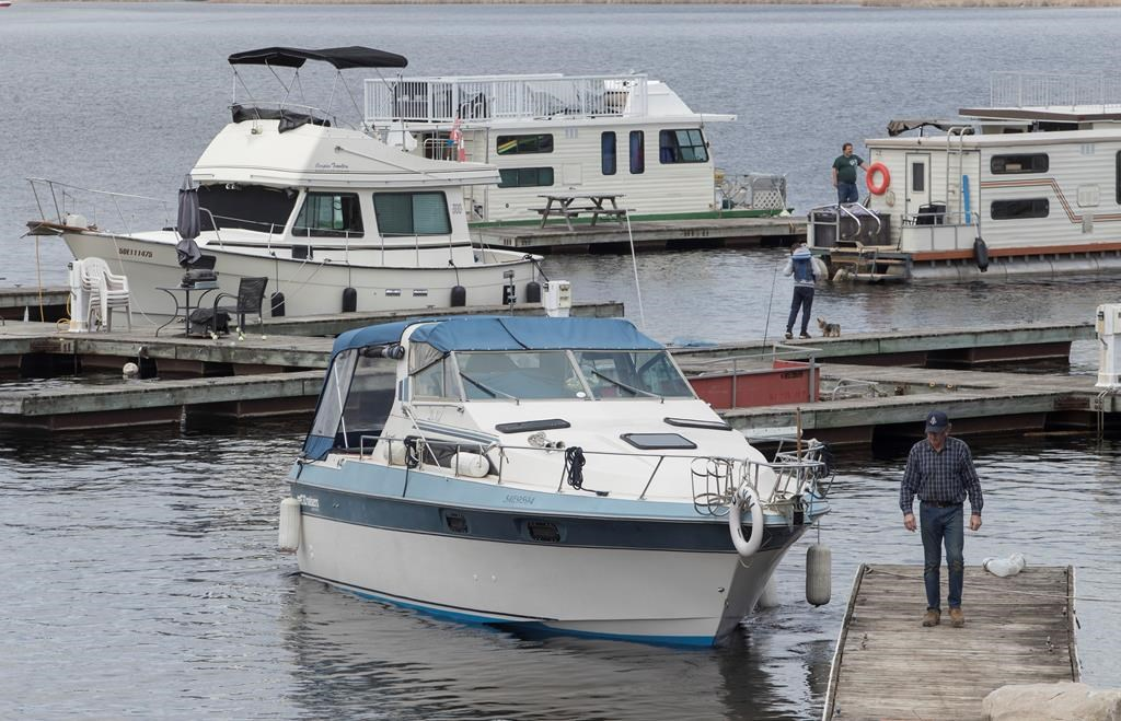 Boats get launched at Kawartha Lakes Marina in Bobcaygeon, Ont. on Saturday, May 16, 2020. THE CANADIAN PRESS/Fred Thornhill.