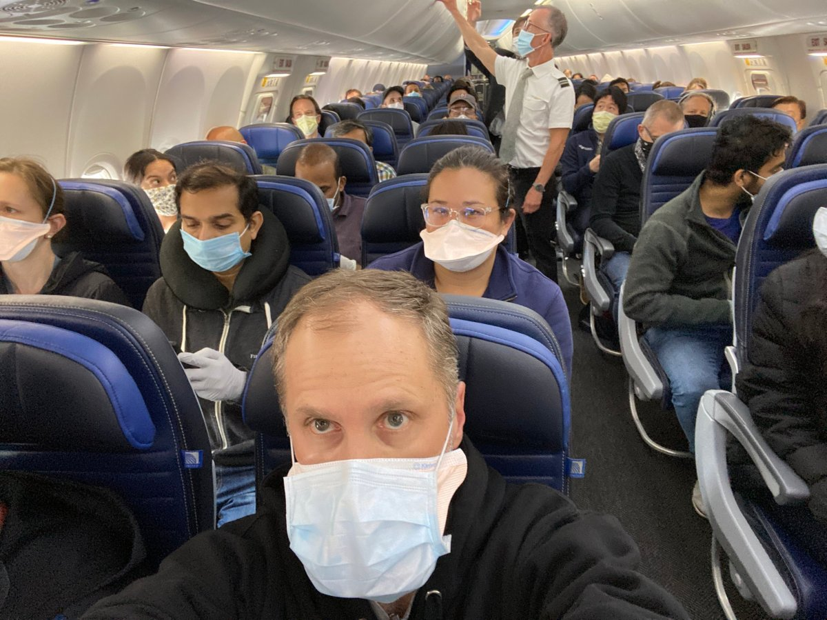 University of San Francisco scientist Ethan Weiss posted a photo of a packed United Airlines flight on Twitter.