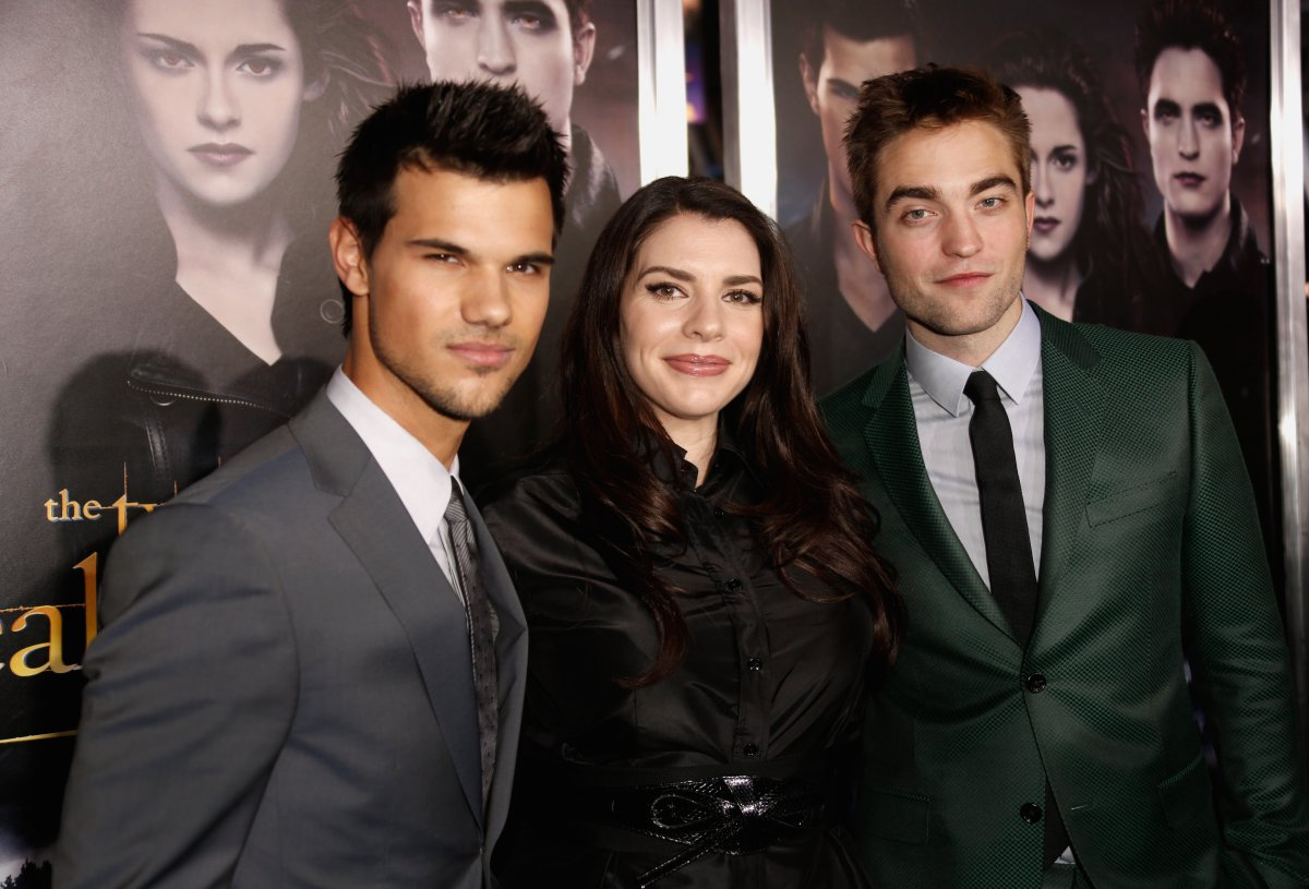 (L-R) Actor Taylor Lautner, author Stephenie Meyer, and Robert Pattinson arrive at 'The Twilight Saga: Breaking Dawn - Part 2' Los Angeles premiere at Nokia Theatre L.A. Live on Nov. 12, 2012 in Los Angeles, Calif.