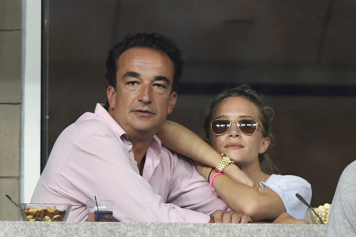 Olivier Sarkozy and Mary Kate Olsen attend Day 8 of the 2014 US Open at USTA Billie Jean King National Tennis Center on Sept. 1, 2014 in New York City.