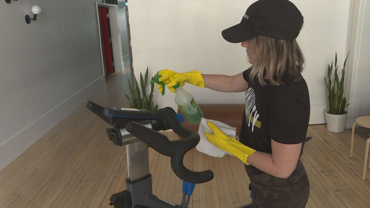 The Community Gym owner Amie Seier cleans equipment at her facility.