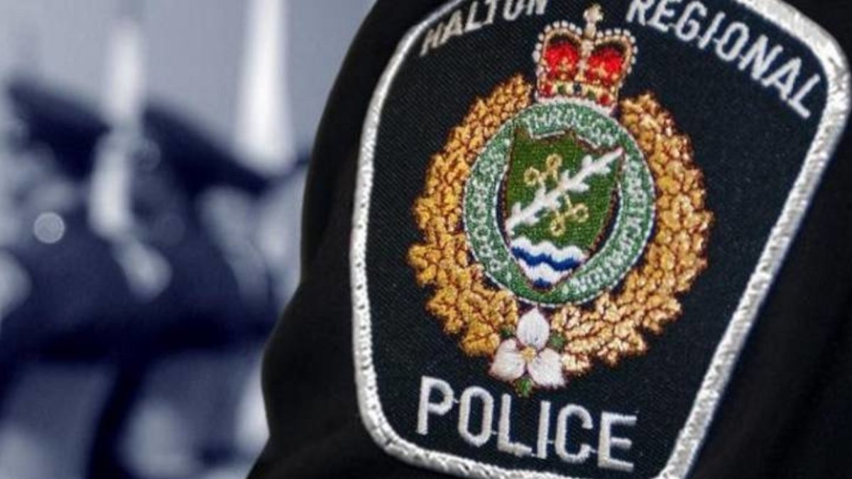 Halton police have charged an Oakville man with assault after spitting at them.