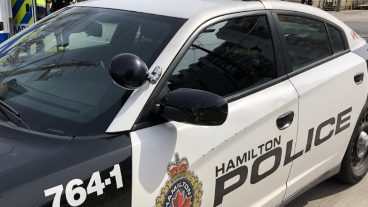 Hamilton police have charged three people  in connection with an incident that involved a car smashing into a police cruiser on May 2, 2020.
