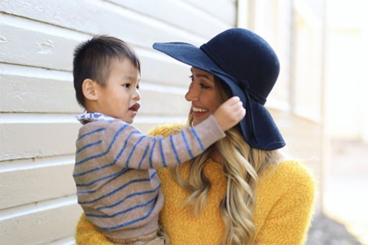 Myka Stauffer, right, is shown with Huxley, a child she adopted from China in 2017.