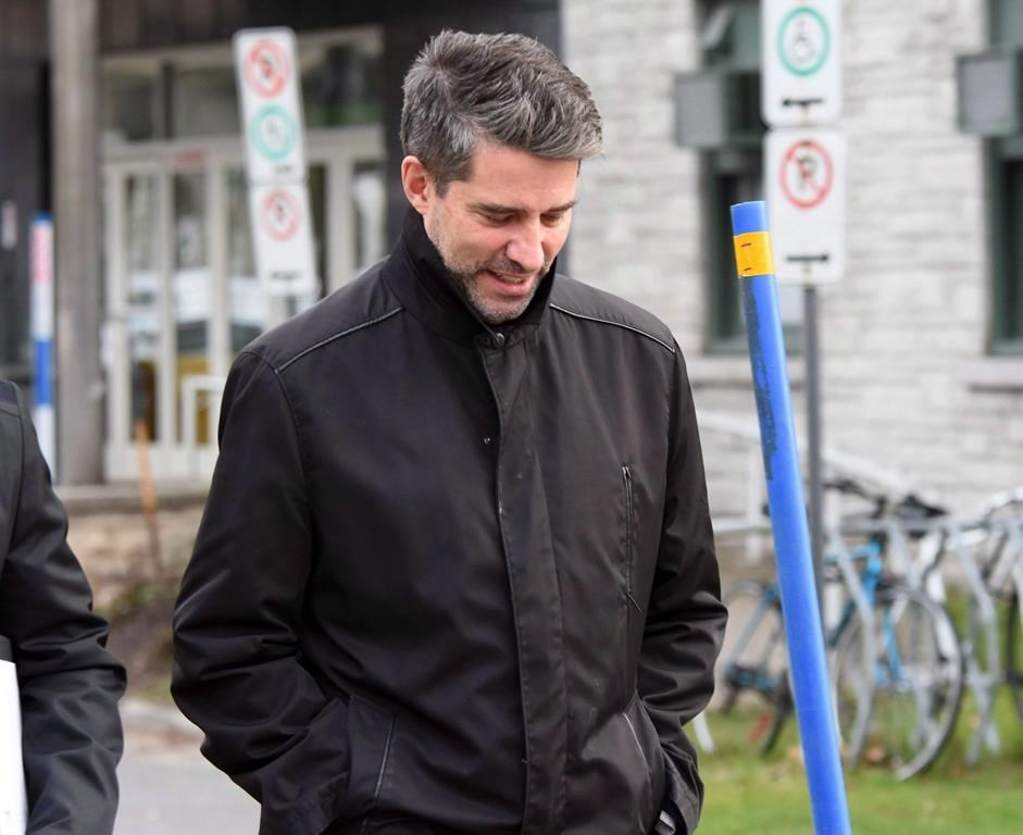 Former PQ chief, Andre Boisclair, exits a police station in Quebec City, on November 9, 2017.
