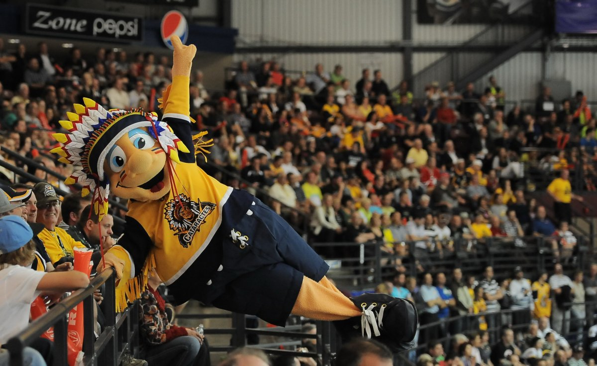 Shawinigan Cataractes mascot Tommy Hawk swings from a railing during the 2012 Memorial Cup tournament.