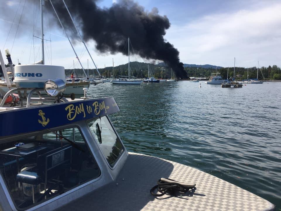 A plume of smoke is seen coming from the North Saanich Marina. One person has died and two people have been taken to hospital with non-life threatening injuries after an explosion and fire.