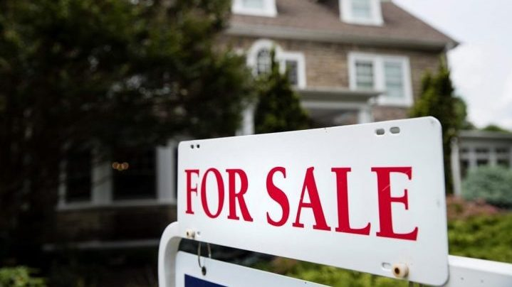 FILE- In this June 8, 2018, file photo a for sale sign stands in front of a house, in Jenkintown, Pa. U.S. home prices accelerated in March 2020 even though sales plummeted, as those Americans still buying bid for a sharply diminished supply of homes. (AP Photo/Matt Rourke, File).