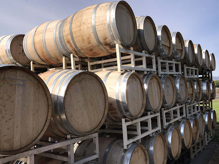 Wine barrels at Deep Roots Winery in Naramata, B.C. Wineries across the Okanagan are reopening their doors for taste testing after the province of B.C. rescinded a closure order last week that was first issued on March 17.
