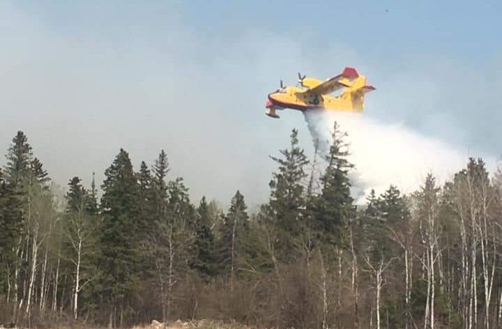 A water bomber near Pine Creek First Nation Wednesday.