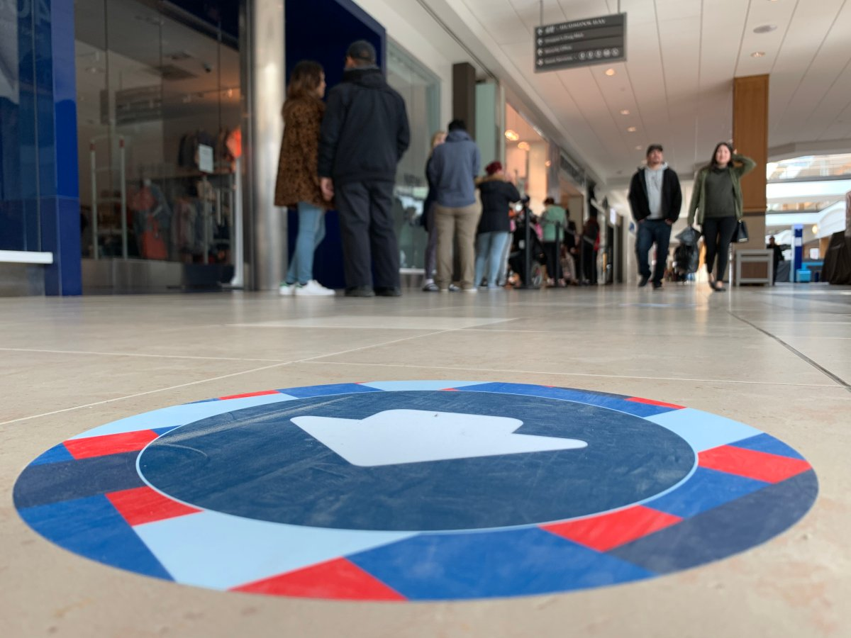 Floor markers help guide shoppers through CF Polo Park to aid in distancing efforts.