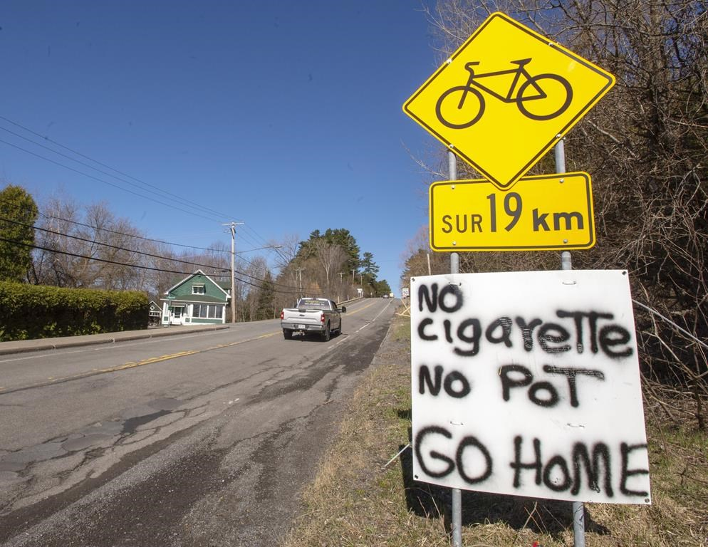 A sign advises non-residents at the entry to the Mohawk territory of Kanasateke to turn around as the community tightens access to the reserve amid the COVID-19 pandemic Monday, April 20, 2020 in Oka, Que. The mayor of Oka, Que., says members of the neighbouring Mohawk community of Kanesatake are blocking access to a provincial park that was supposed to partially reopen today.