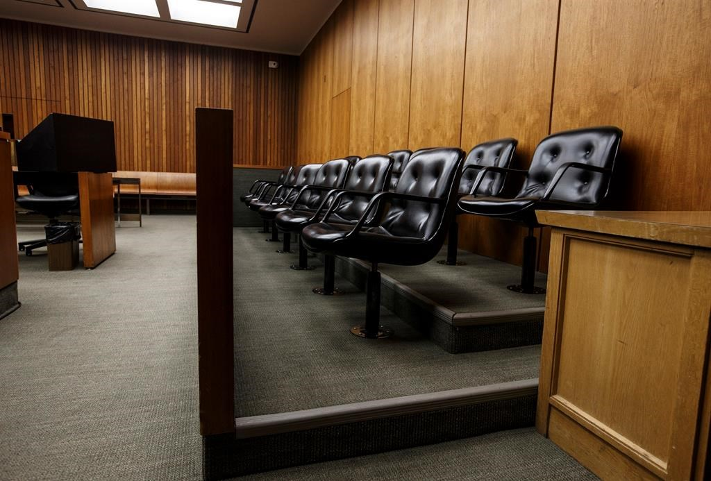 A jury box is shown in a courtroom at the Edmonton Law Courts building in Edmonton on Friday, June 28, 2019. An Edmonton criminal law firm says COVID-19 restrictions in Alberta's courthouses have led to an untenable situation. THE CANADIAN PRESS/Jason Franson.