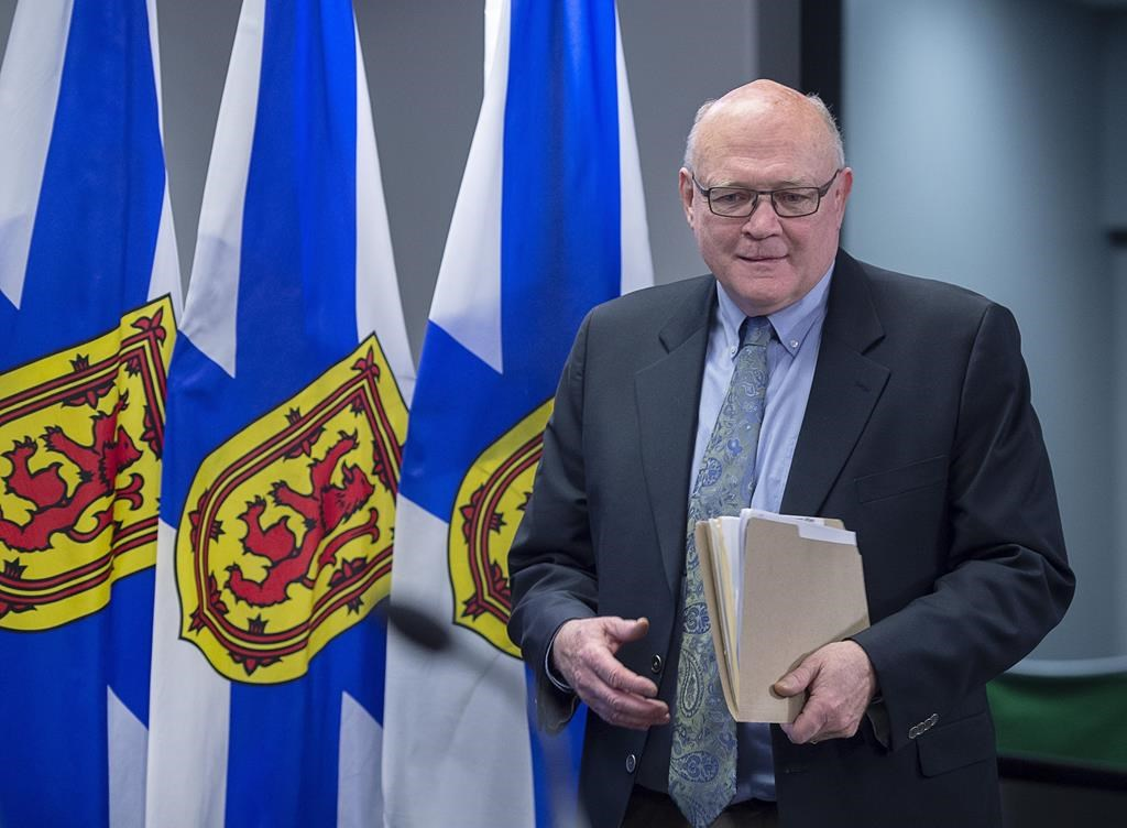Dr. Robert Strang, chief medical officer of health, arrives to deliver an update on health system preparations in Nova Scotia for the coronavirus that causes COVID-19, in Halifax on Friday, March 6, 2020.