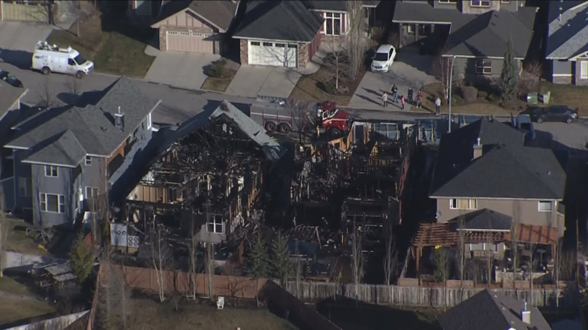 A home in northwest Calgary was destroyed and two others were damaged in an early Saturday morning fire.