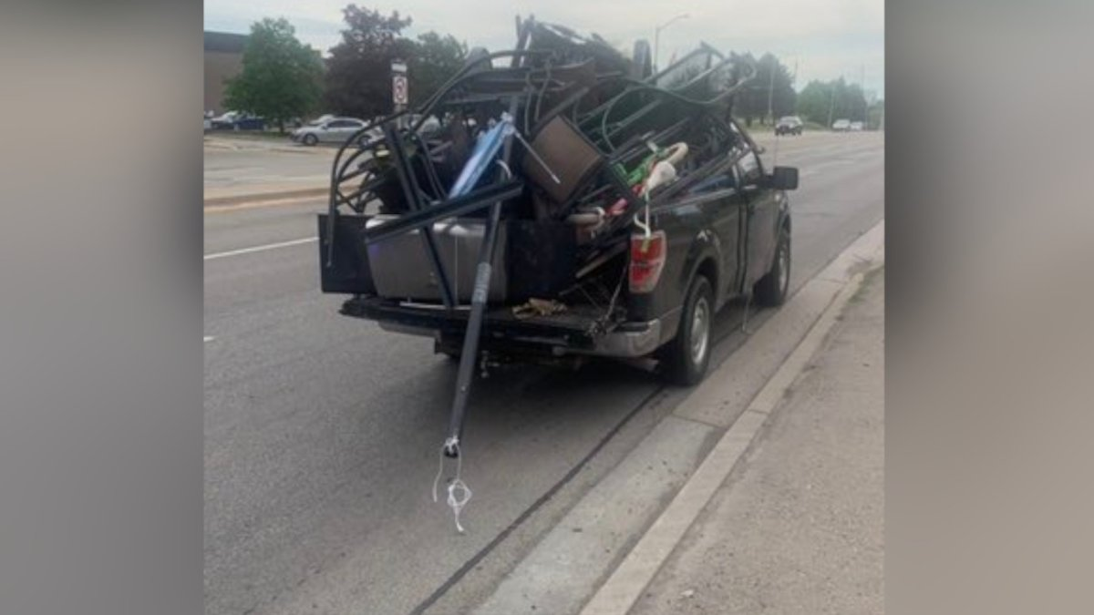 A driver is facing multiple charges after driving his overloaded vehicle on a busy thoroughfare in Burlington on Thursday night.