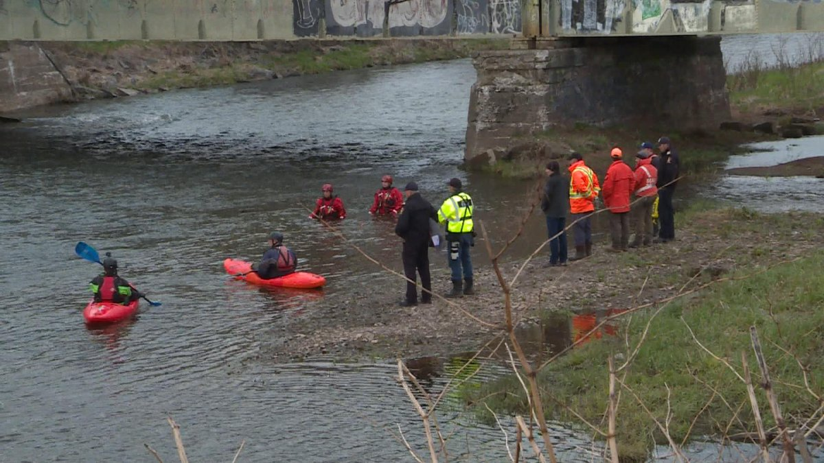Search and rescue crews launch a mannequin in the Salmon river on May 13, to track it's movements with the current.