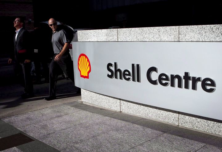 Pedestrians walk past Shell Canada's headquarters during a news conference in Calgary, Thursday, Aug. 26, 2010.