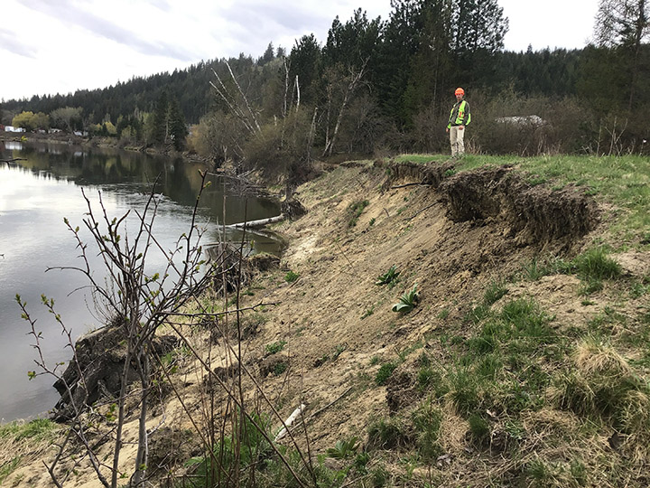 A technical expert assess rising waters and erosion on the rail trail along the Shuswap River this spring for the Sicamous to Armstrong rail trail development plan.