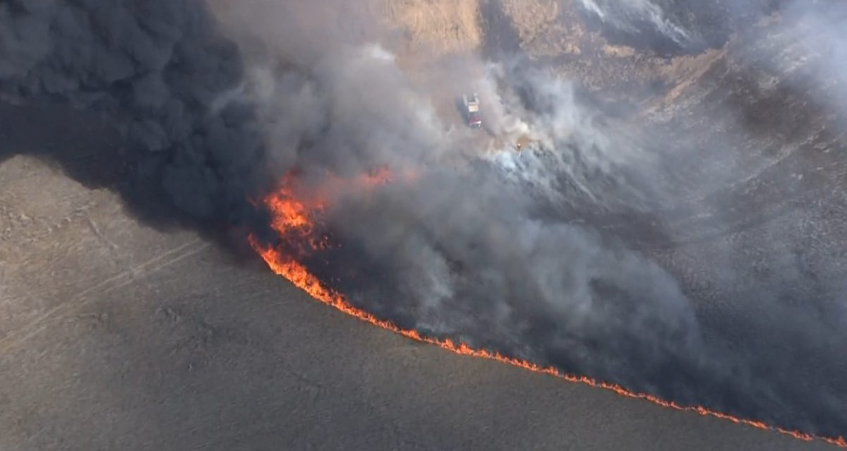 An aerial shot by Global1 as crews from the Calgary Fire Department and Tsuut'ina Nation battle a wildfire in the city's southwest on Friday, May 1, 2020.