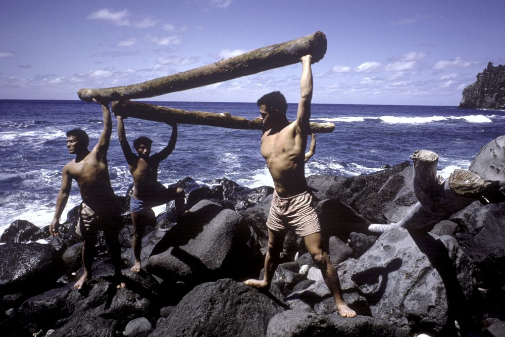 A group of teenagers re-enact their castaway lifestyle on 'Ata in Tonga in 1966.