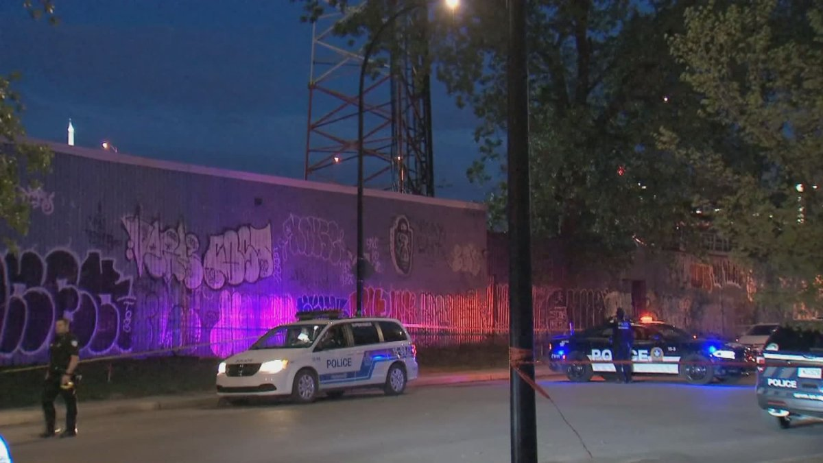 Montreal police officers respond to a suspected incident of arson at a cellphone tower in the city's Sud-Ouest borough early the morning of May 25, 2020.