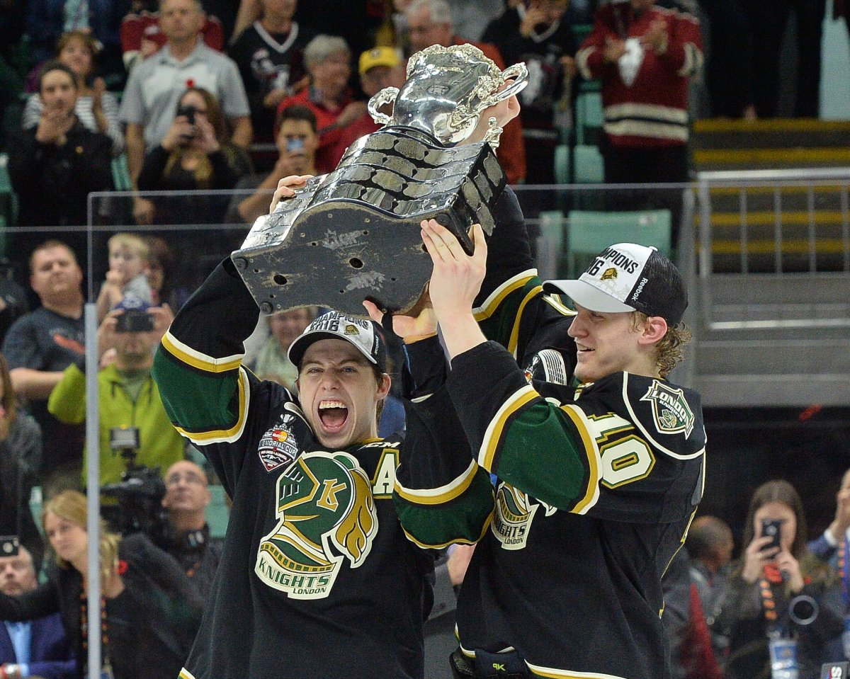 Co Captains Mitch Marner and Christian Dvorak of the London Knights hoist the Memorial Cup at the 2016 MasterCard Memorial Cup in Red Deer, Alberta on Sunday May 29, 2016. Photo by Terry Wilson / CHL Images.