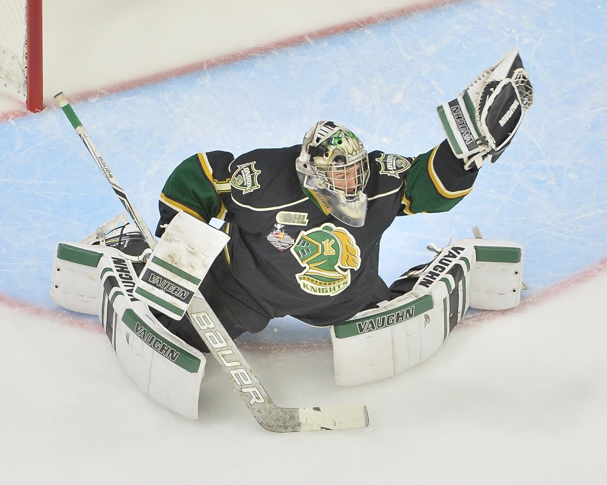 Red Deer, Alta. - Tyler Parsons of the London Knights makes a glove save during the 2016 Memorial Cup tournament.