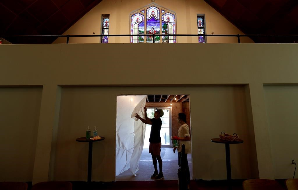 Alamo Heights Baptist Church pastor Bobby Contreras, left, and his wife Hannah, work to clean, sanitize and prepare the church for services this Sunday, in San Antonio, Texas, May 6, 2020.