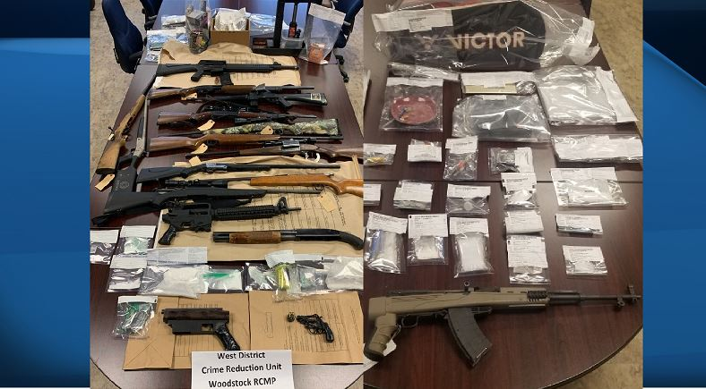 Police say 17 weapons and drugs were seized as a result of the two search warrants being executed.