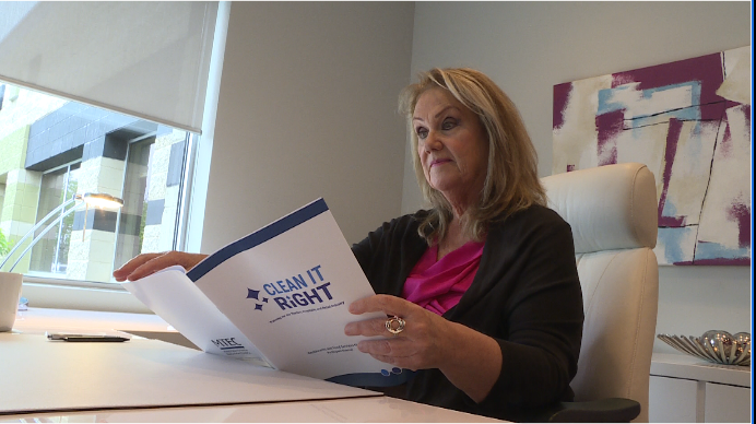 Manitoba Tourism Education Council CEO Shannon Fontaine reviewing the curriculum for her business's new cleaning course.