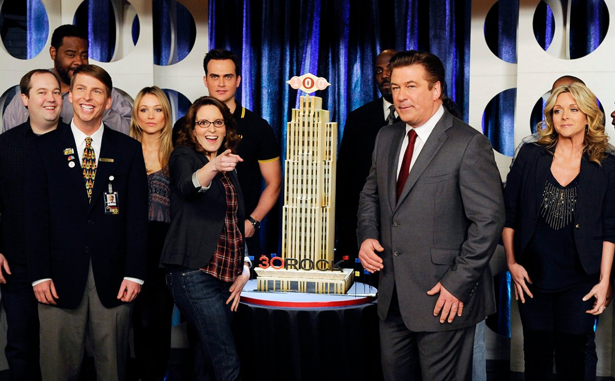 Cast members from '30 Rock,' including front row from left, Jack McBrayer, Tina Fey, Alec Baldwin and Jane Krakowski celebrate the 100th episode taping of the show at Silver Cup Studios on March 10, 2011 in New York City.