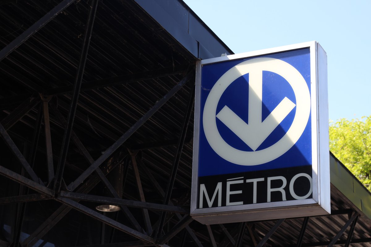 A sign hangs outside a métro station in Montreal, Que.