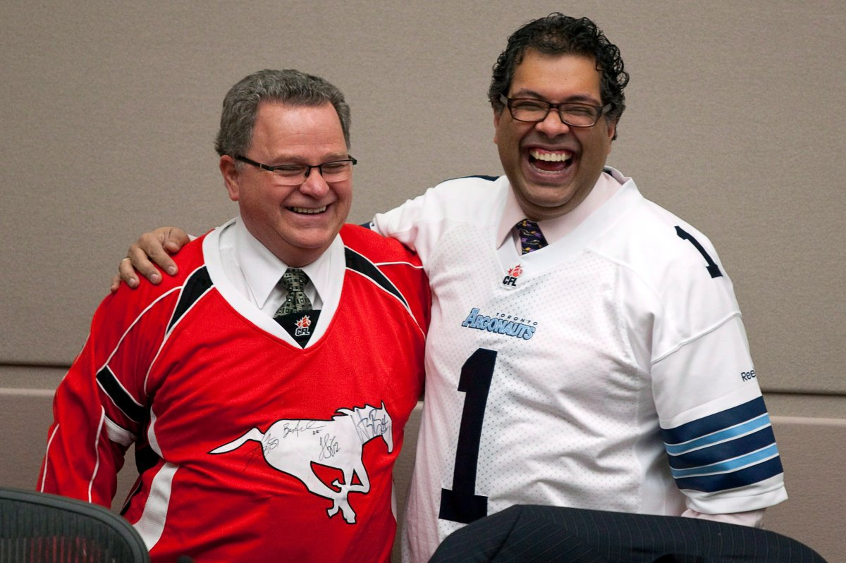 Calgary Mayor Naheed Nenshi, right, wears a Toronto Argonauts jersey as Councillor Shane Keating wears a Calgary Stampeders jersey before a council meeting in Calgary, Alta., Tuesday, Nov. 27, 2012. Keating announced on June 22, 2020 he would not seek re-election in the 2021 municipal election.