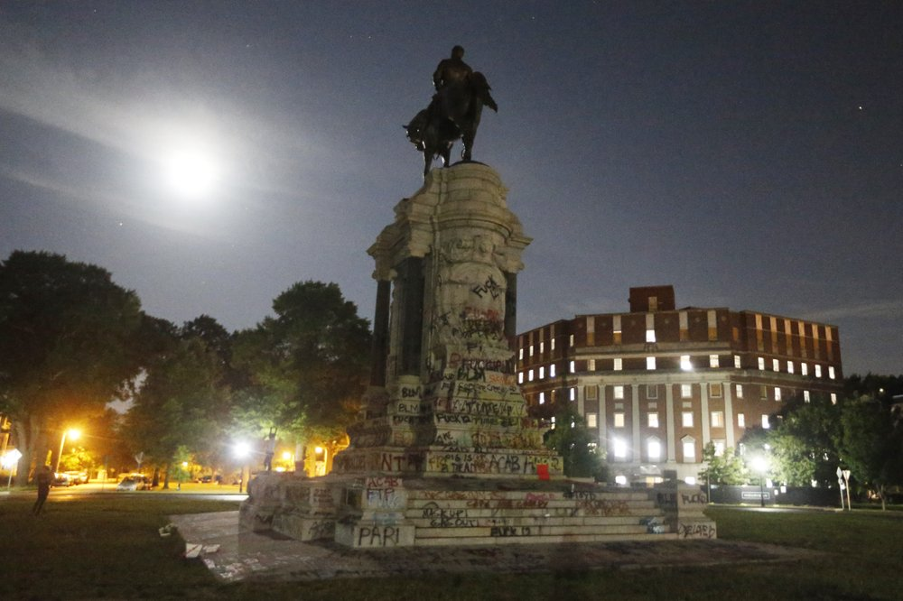 The Moon illuminates the statue of Confederate General Robert E. Lee on Monument Avenue Friday June. 5, 2020, in Richmond, Va. Virginia Gov. Ralph Northam has ordered the removal of the statue.