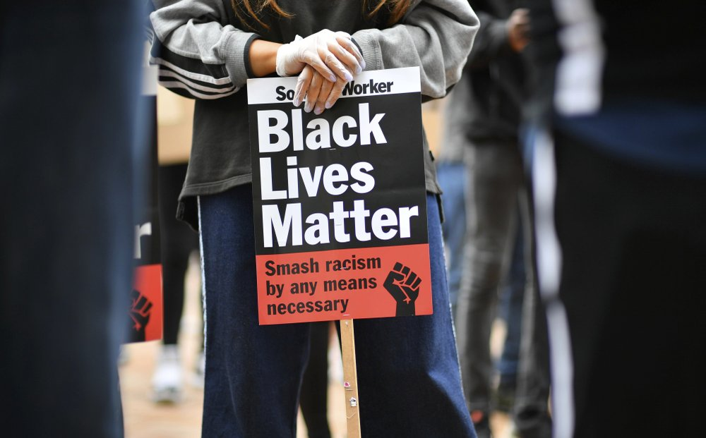 People listen to speeches during a rally to support the Black Lives Matter movement in Birmingham, England, Friday June 19, 2020. A white U.S. Police officer in Minneapolis, recently killed black man George Floyd, sparking anti-racism protests worldwide, and the Black Lives Matter movement hoping to enable reforms and greater social justice.