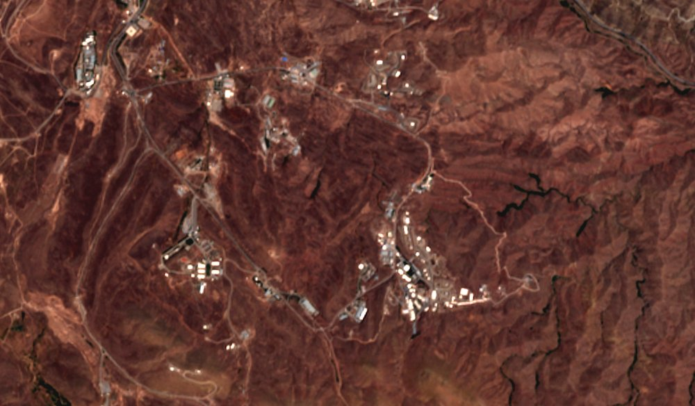 This June 21, 2020 photo from the European Commission's Sentinel-2 satellite shows a site before an explosion June 26, 2020, that rattled Iran's capital. Analysts say the blast came from an area in Tehran's eastern mountains that hides a underground tunnel system and missile production sites.