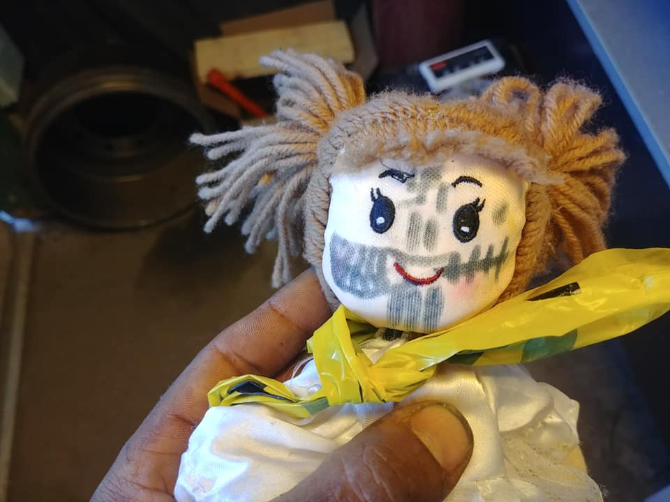 Brown says he arrived at work to find this doll in his mailbox.