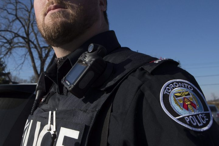 A Toronto police officer poses for a photo wearing a body camera as part of his equipment while on duty in Toronto on Nov. 25, 2015.
