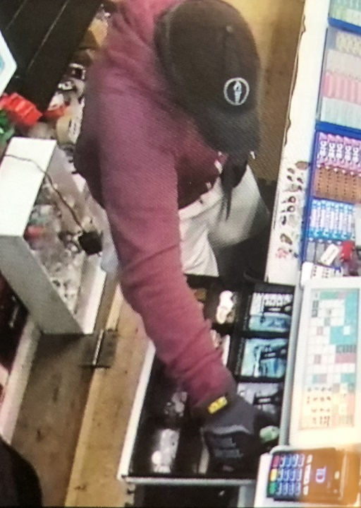 Kingston police are looking for the man in this photo, who allegedly stole cash from a Kingston convenience store.